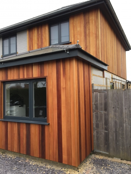 ST6 Cedar Cladding finished in Textrol HES