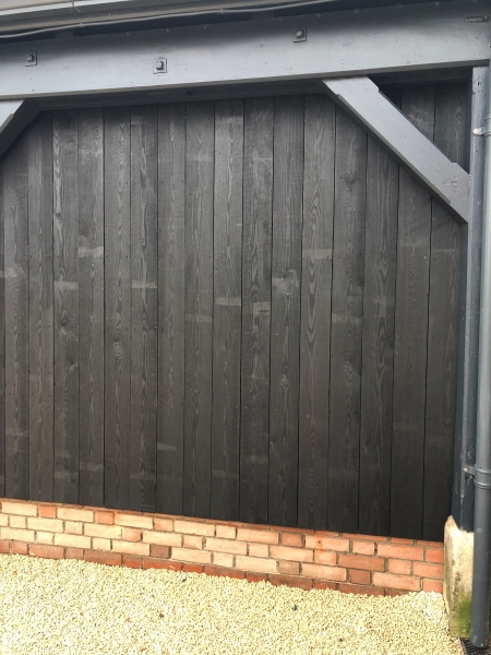 Siberian Larch U/S Grade 25x150mm sawn painted black